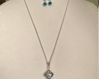 A blue glass bead pendant