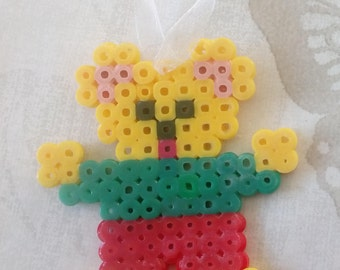 Juju bag or child model in hama beads: dressed bear