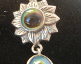 Vintage sterling silver sunflower pendant with color-changing mirage cabochons.  Sunflower pendant.  Silver sunflower pendant with mirage.