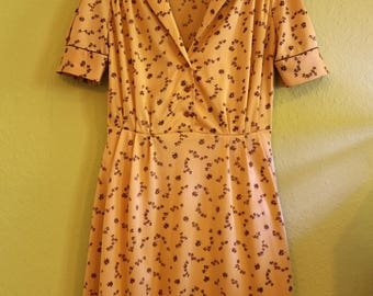 Original diner dress from the 50s-60s yellow with floral pattern