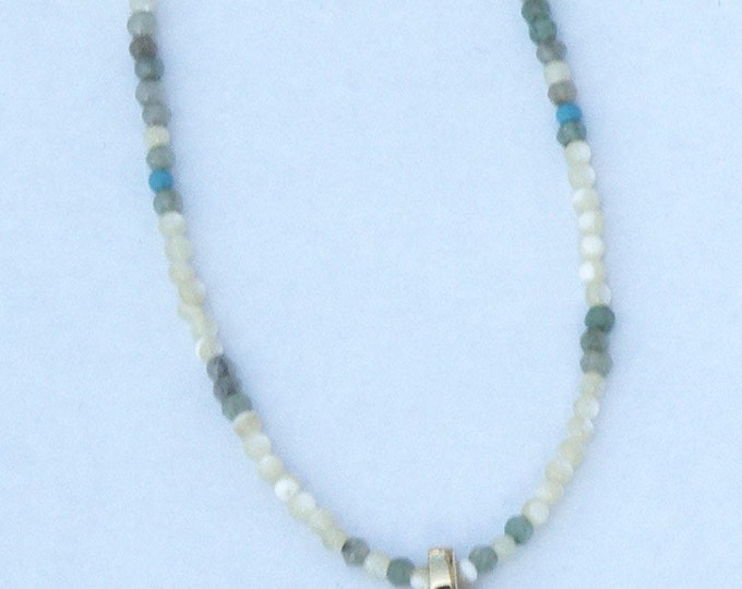 Necklace with a horn pendant and semi precious beads