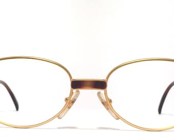 Vintage eyewear. Missoni eyewear. Exceptional oval brushed gold frame with tortoise detailing. Excellent condition! Made in Italy 1980's.