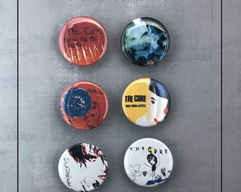 """The Cure - Discography 1.5"""" Button Collection - Kiss Me, Kiss Me, Kiss Me, Disintegration, Wish, Wild Mood Swings, BloodFlowers"""