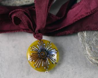 NC. Sacred spiral glass pendant