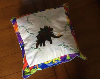 Small dinosaur cushion