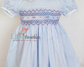 Beautiful light blue hand smocked and embroidered baby dress - size 1