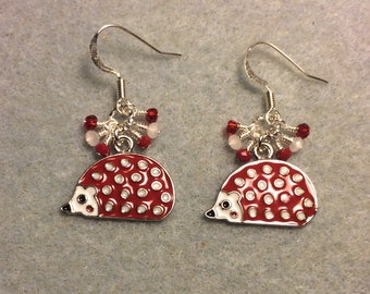 Red and white spotted enamel hedgehog charm earrings adorned with tiny dangling red and white Chinese crystal beads.