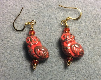 Red and brown fancy Czech glass owl bead earrings adorned with red Chinese crystal beads.