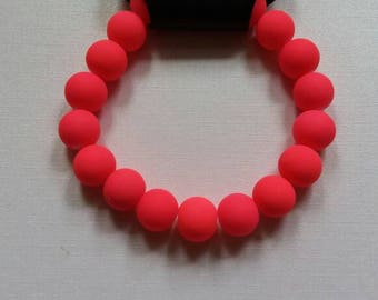 Neon pink elastic bracelet. REACTS TO BLACKLIGHT !
