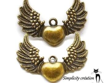 "pedentif ""Winged heart"" charm bronze 34x25mm"