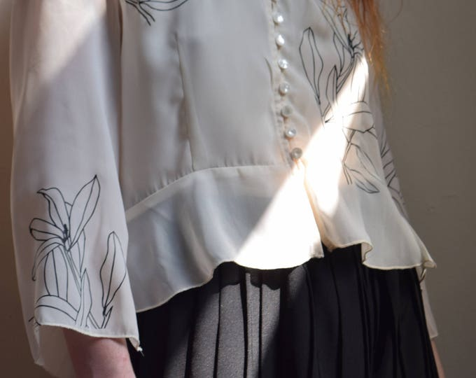 Ren sheer blouse.
