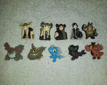 Lot 10 jibbitz Dragons (badges for fangs)