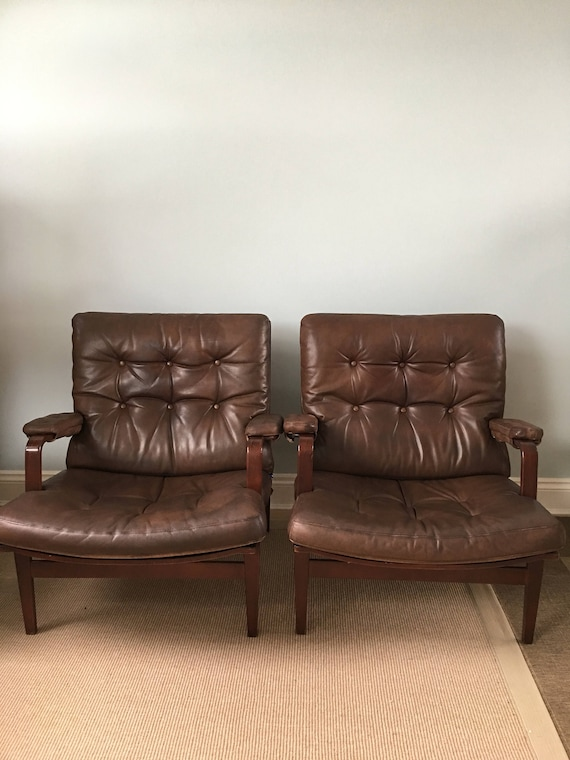 A pair of Bruno Mathsson Ingrid chairs by Dux in leather and rosewood stained frame circa 1970's