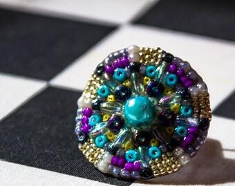 bague mandala en perles bleues et argentées
