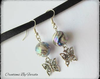 earrings with a butterfly pendant and Pearl effect black wave
