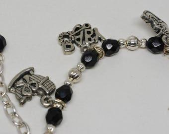 "Silver tone ""new born"" charm bracelet"