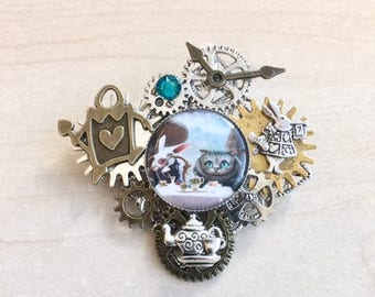 Steampunk Alice in Wonderland with gears and cabochon pin