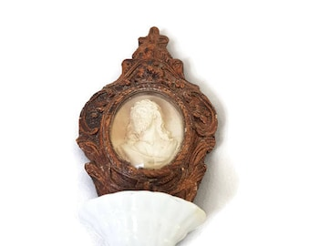 antique wooden holy water font with meerschaum scene and convex glass, antique hand carved stoup