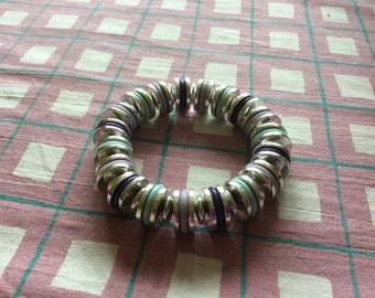 Silver coloured disc bracelet