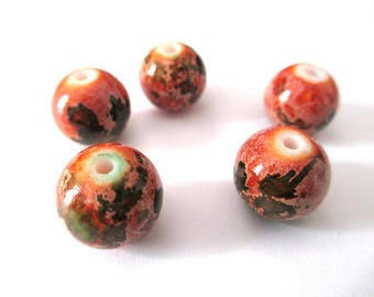 5 orange speckled green glass beads 12mm