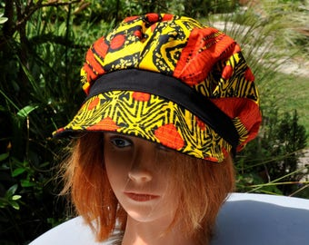 CAP in Designer for women, slouchy shape in wax print red yellow black - size 57.5 cm