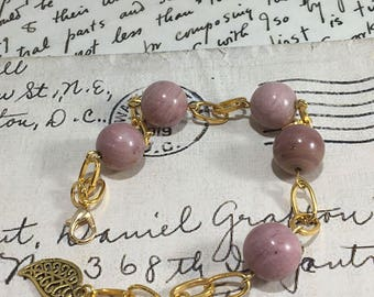Gold plated bracelet with Pink Chondrodite beads.