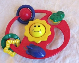 Fall Sale Vintage multi coloured, multi activity rattle. Stroller/crib/car seat toy.