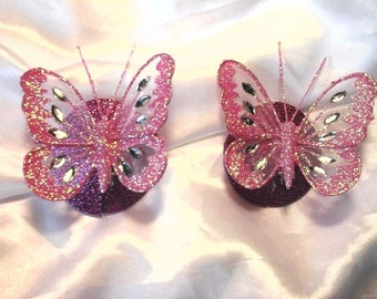 Hot pink glittery nipple pasties with 3D butterfly.