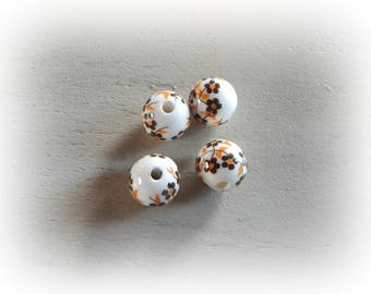 4 patterned Brown and orange flowers and 12 mm white ceramic round beads