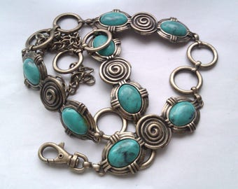 silver coloured belt with turquoise coloured beads