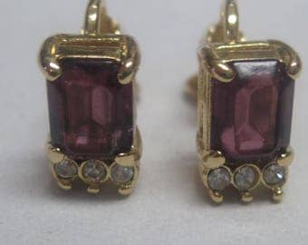 Costume Gold Toned Clip on earring with Purple Stone and Diamond like stones.