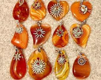 Orange agate pendants with sun charms and swarovski crystals, your choice of 12 - count from left to right starting top oeft corner