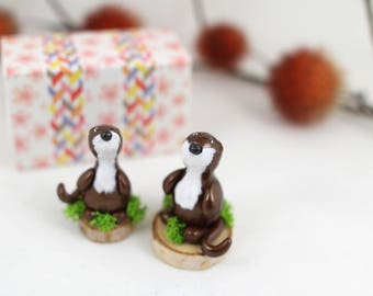 Couple of small weasels cold porcelain