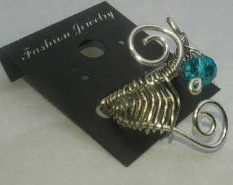 beautiful wire wrapped spiral ring with aqua blue glass bead. braided wire ring. wire wrapped jewelry