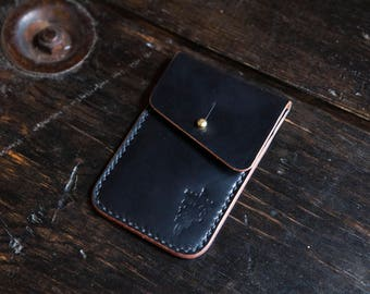 Black Shell Cordovan with Stud Closure Flap and Reverse Shell Branded Pocket Detail
