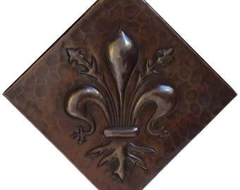 4x4 Hammered Copper Tile - Fleur De Lis Design on a diagonal