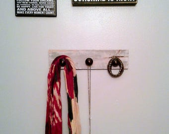 3 knobbed reclaimed wood wall hanging