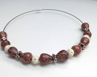 Semi-rigid necklace made of Leopard skin Jasper, carved ivory and rings