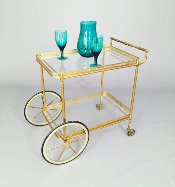 Art Deco 2 brass & metal shelves cart on wheels.