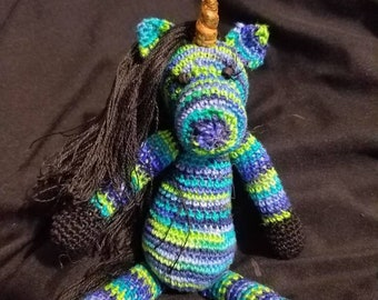 Frank, the hand crocheted collectable miniature zebracorn/unicorn