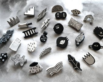 Pins black and white shapes various