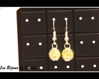 Earring with its yellow crackled bead cage