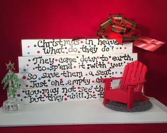 Christmas in heaven what do they do?They come down to earth to spend it with you,so save them a seat, just 1 empty chair, Christmas in July