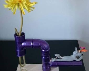 rat vase lying on pipe