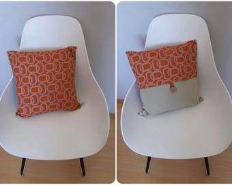 Geometric patterned pillow cover in orange and taupe light