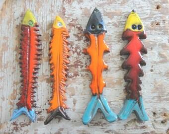 4 fish in ceramic, wall art