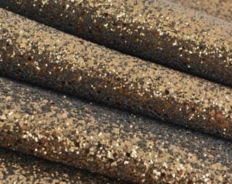 Glitter fabric, brown . Brown chunky glitter fabric. Bow making fabric. Just brown