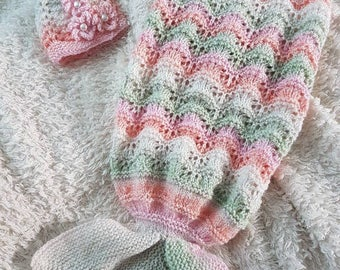 Beautiful handknit baby cocoon with matching hat
