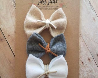 Adorable handmade felt bow in natural color tones