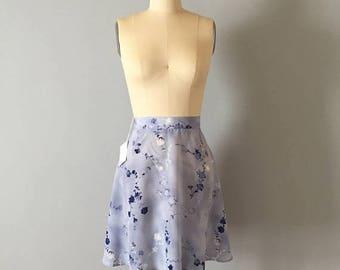 20% OFF SALE... muted flowers sky blue mini skirt // 1990s skater mini skirt